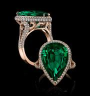 A ring featuring a 9.25-carat pear-shape emerald.