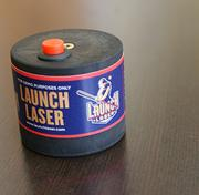 The launch laser can attach to the knob of a typical baseball or softball bat. It emits a laser beam that helps guide the player into the optimal hitting position.