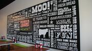 Mooyah messages abound on a sign greeting guests as they arrive.