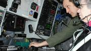 Lt. Col. Mike Moeding shows off some of the instrumentation of the KC-135 to Cathy Feemster of East Wichita News.