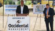Mayor Carl Brewer addresses attendees at Occidental Management Inc.'s ground-breaking for its Offices at Cranbrook project on Friday. To the right is Chad Stafford, president of Occidental.