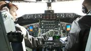 Lt. Col. Pam Freeland, left, and Capt. Whit Nanna at the controls of a KC-135.