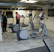 The fitness room has five pieces of cardio equipment.