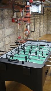 The foosball table in the basement's entertainment room.