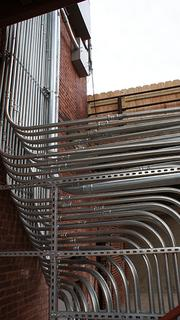 Who knew conduit could be artistic? These curves catch your eye on the northside of the building. Organ pipes for the Player Piano building?
