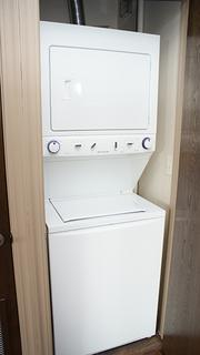Stackable washers and dryers are tucked into the units.
