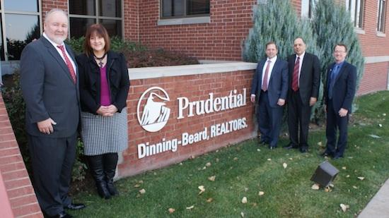 Willie Kihle and Mona Stein, at left, are selling their ownership stakes in Prudential Dinning-Beard Realtors to PenFed Realty LLC. In the background, from left, are James Schenck, president of The PenFed Group, Shashi Vohra, executive president of The PenFed Group, and Tom Carruthers III, vice president-mergers and acquisitions for The PenFed Group.