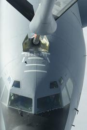 Refueling another KC-135 — while flying at nearly 600 mph.