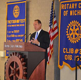 Steve Coen, president and CEO of the Kansas Health Foundation, addresses members of the Rotary Club of Wichita at Botanica on Monday afternoon.