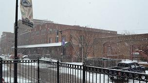 Snow blows through Old Town early Monday afternoon.