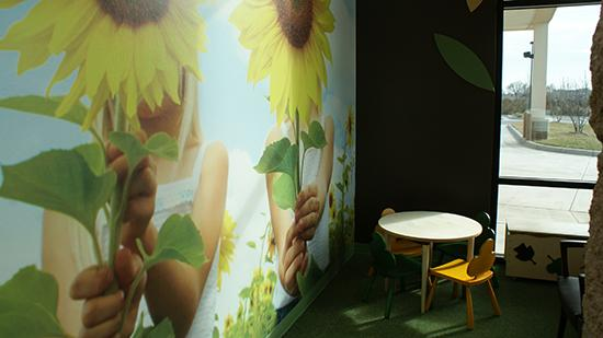 Many of Surgicare's patients, as much as 33 percent of its business, are kids who are treated for ear, nose and throat issues. Part of the waiting room includes a children's area that features a Kansas-themed sunflower mural. Pictures from around the state are on display throughout the facility.