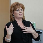 Tracie Johanek, Surgicare's practice administrator, talks to reporters Thursday.