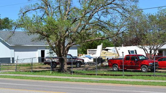 A home is damaged across the street from the Hawker Beechcraft plant.