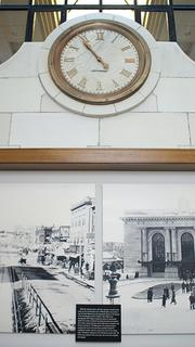 A clock and historic photos of the station in the former ticket counter area of Union Station.