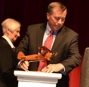 Campaign Chairman John O'Leary received a wooden statue of a Stearman Aircraft Corp. airplane for his involvement with the United Way's 2012 campaign.