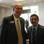 Jerry Gray, Weigand vice president and general manager of its commercial division, and George Laham, president of Laham Development.