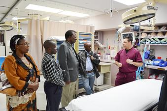 Mike Valdez, right, Wesley Medical Center's trauma department manager, talks about the hospital's trauma and emergency room procedures with members of a delgation from Uganda that toured the hospital Wednesday.