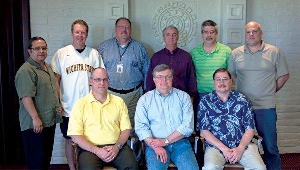 Back row, from left: Vince Tafolla, Glenn Steele, James Magonegil,  Mark Kirkpatrick, Scott Graves, Steve Spencer. Front row, from left:  Craig Befort, Jeff Landreth, Gene Johnson.