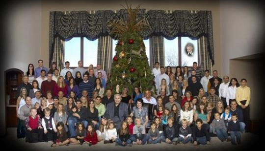 Joe Steven and his wife, Esther, sit in the center of a family photo that includes 100 people. Steven had 11 children.