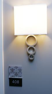 A wall sconce outside one of the rooms.