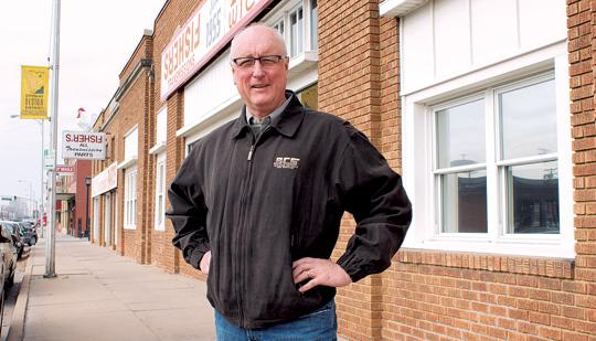 Ken Stoppel, owner of Building Controls and Services Inc., is overseeing the renovations at 1730 E. Douglas, where his company will move next year.