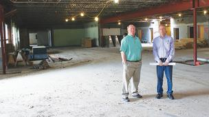 LakePoint Augusta LLC partners Warner Harrison, left, and Kevin Unrein are converting the former Augusta Regional Medical Center into LakePoint Business Park, which will include an events center in the space seen here.