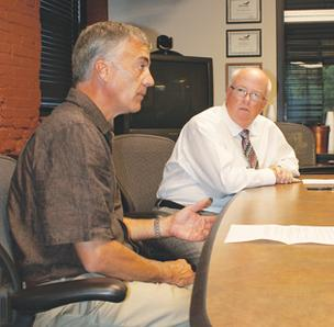 Chamber President Walt Berry, left, and CEO Gary Plummer at WBJ on Wednesday.