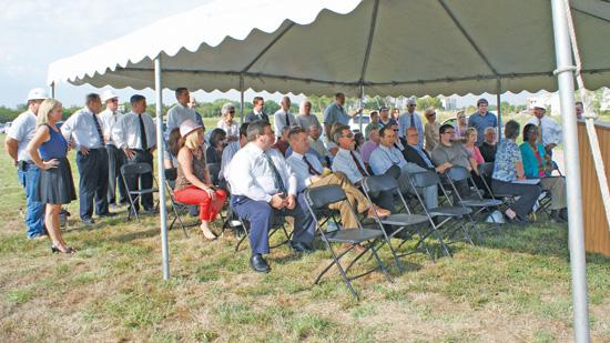 The ceremonial groundbreaking on Chisholm Lake Apartments attracted a crowd Tuesday. The companies planning and building the project are taking ownership stakes in it rather than collecting their normal fees.