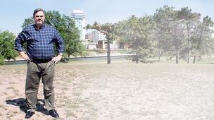 "Scott Knebel stands on the west bank of the Arkansas River, one of the city's eight downtown ""catalyst"" sites."