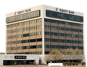 Equity Bank is involved with a dispute with US Bank over four small mortgage loans.