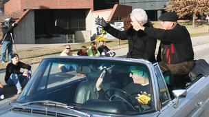 Don and Shirley Beggs wave to students during a homecoming  parade at WSU. Past and present students alike say the Beggses put great importance on being involved with students.