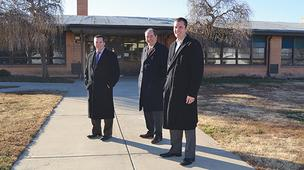 In February, J.P. Weigand & Sons Inc. will be auctioning the former Mueller Elementary School building near 24th Street North and Hillside. Weigand agents Bradley Tidemann, left, John Rupp, center, and Grant Tidemann are involved in marketing the property for Wichita Public Schools.