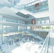 Renderings of the University of Kansas School of Business's planned $60 million building.