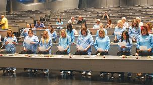 WATC dental assistant students read their occupational oath at a graduation ceremony this week.