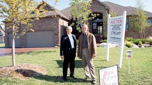 Residential real estate broker Dave Neal, left, is helping home builder Bob Cook move one of his long-standing spec homes by putting it up for auction.