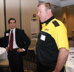 Chris Purdum, of Commerce Bank, left, and Robert Yelverton, of Line-X, were among the attendees.