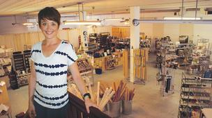 Emily Brookover, owner of Bluebird Arthouse at 924 W. Douglas, is looking forward to having Friends University's art department next door. It's good not just for her business, but for the entire Delano District, she says.