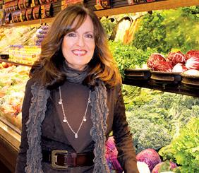 Barb Hoffmann owns Green Acres Market at Bradley Fair. She's about to open a Green Acres Market in suburban Tulsa. Whole Foods Market seems to be making plans to meet the new competition there.