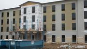 The façade of the new Hampton Inn & Suites is taking shape on one side of the hotel at the Kansas Star Casino. The first phase of the hotel, 150 rooms, will be completed by January. The hotel is being developed by KSC Lodging LC of Topeka. Another 150 rooms will be added within two years.