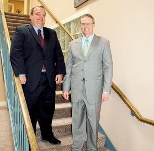 Troy Gott, left, and John Brennan, opened Brennan Gott Law PA in July in the Old Town Law Offices building at 218 N. Mosley. They say the downtown building gives them a central location.