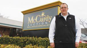 "Braden McCurdy, associate broker at McCurdy Auction in Wichita, says more sellers are choosing the absolute auction route, where there's no minimum and ""whatever the last bid is, it sells, regardless of price."""