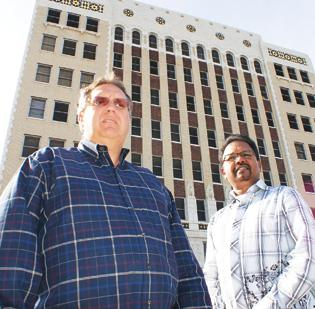 Kyle Hughes and Emmanuel Kolluri are part of a three-person investment group, KAH Investments, hoping to turn around the fortunes of the Petroleum Building.