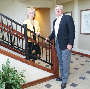 Jodie Leeser and Dan Reiners, co-managers of the new PrimeLending branch in east Wichita, stand in the lobby of the Hinkle Law building at Wilson Estates Office Park, where the branch will open next week.