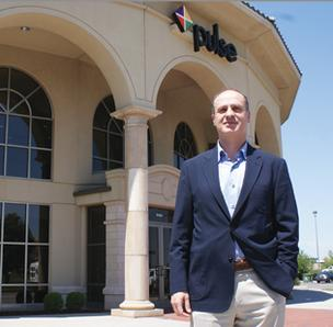 Basil Hourani, CEO of Pulse Systems Inc., says the company's new space encourages collaboration. The 24,000-square-foot office includes four meeting rooms and a large training room.