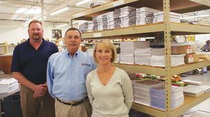Rob Galaway, left, general manager at Quik Print, and company owners Johnny and Susie Tarrant are  eyeing several  services as independent divisions of the business.