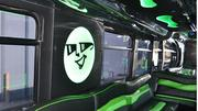 The Spot's Party Bus logo is displayed prominently in several of the company's busses. Here, the logo and seating are used to block off a second door. It is also covered over on the outside. The company's fleet is converted city buses, which feature a second passenger door.