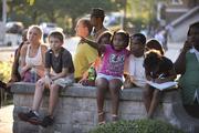 Children watch the festivities at the park.