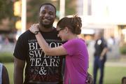 Samford Universtiy students Sidney Jordan and Melanie Brummette watch the festivities at Kelly Ingram Park Wednesday.