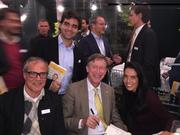 """Colorado Gov. John Hickenlooper signs copies of his book, """"The Opposite of Woe: My Life in Beer and Politics,"""" for fans in Brazil."""