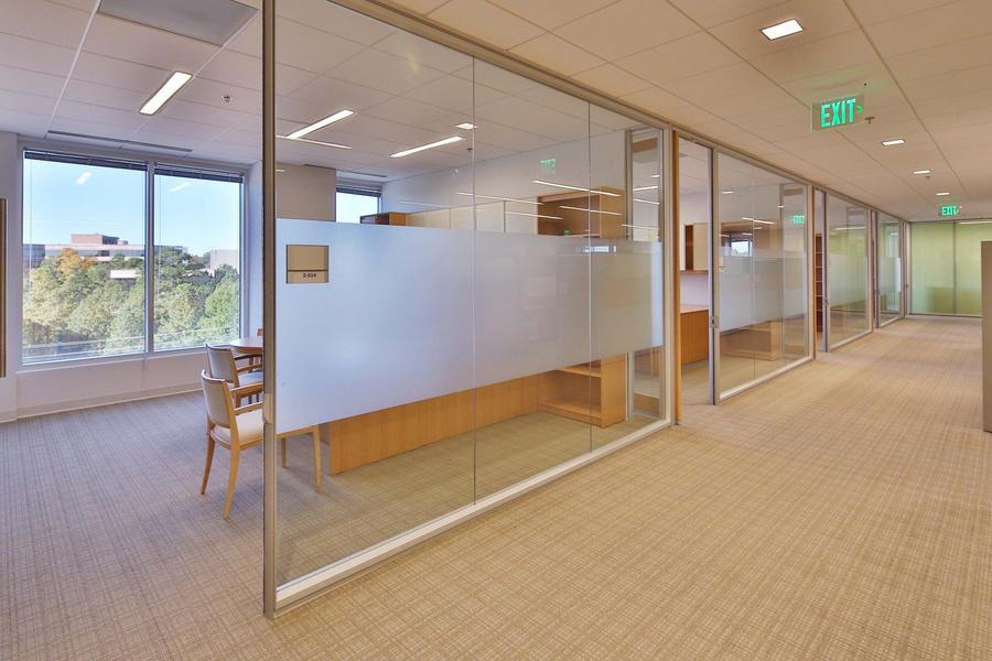 Frosted bands provide privacy for these beautifully open offices